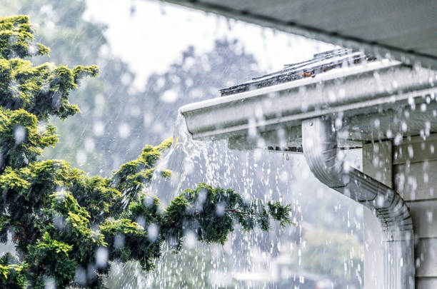 Photo of gutters under a heavy downpour - Getty Images/iStockphotos